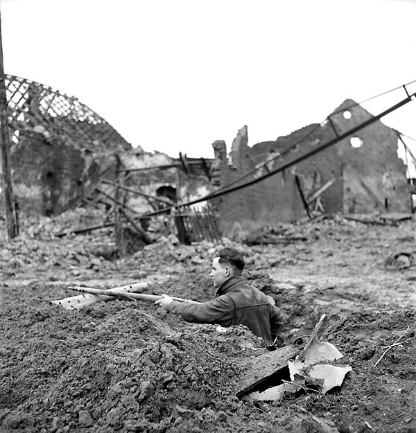 Canadians in Germany - Rifleman J. Boehm of the Regina Rifle Regiment in position among the ruins of Zyfflich, Germany, 9 February 1945.