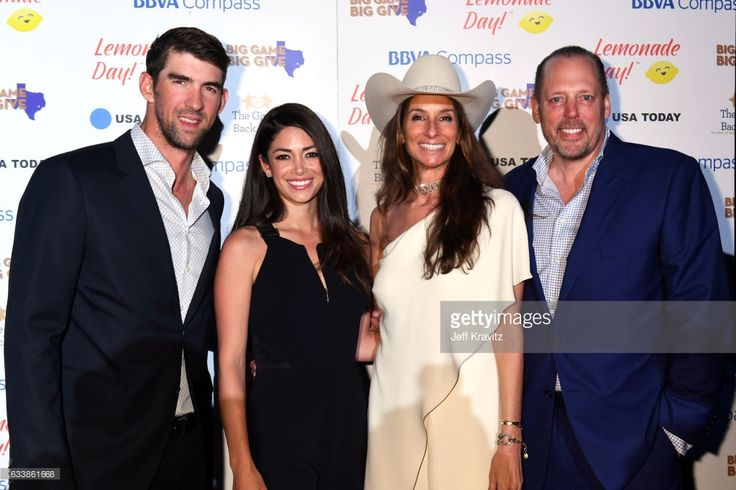 Swimmer Michael Phelps, model Nicole Johnson, Lisa Holthouse and Michael Holthouse attend the Giving Back Fund's 8th Annual Big Game Big Give Charity Event at Holthouse Estate on February 4, 2017 in Houston, Texas.
