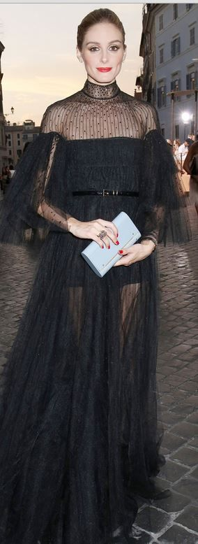 Who made  Olivia Palermo's black mesh long sleeve gown?