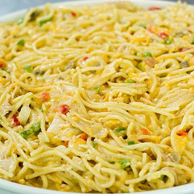 Chicken Spaghetti -Pioneer Woman.-I used 16oz. pasta and doubled chicken. Didn't double soups, but added3/4 c. broth and 3/4 c. sour cream. I used frozen peas instead of peppers.  Filled a 9x13 plus a little extra.Covered and added cheese last half of bake time.