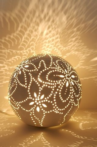 The play of light and shadow created by the perforations in this handcrafted porcelain sphere by Austrian design studio Feinedinge is so lovely. It would be breathtaking in a bedroom or on a living-room tabletop, where it would throw a delicate pattern of illumination onto the walls in the evening. Talk about mood lighting.