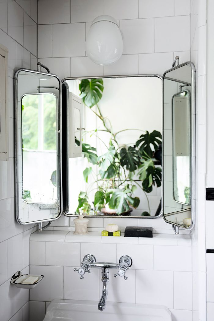 In this bathroom, a monstera has been positioned directly behind the mirror to effectively double the leafy view. Via Elle Decoration Sweden. Photography by Johan Sellén.