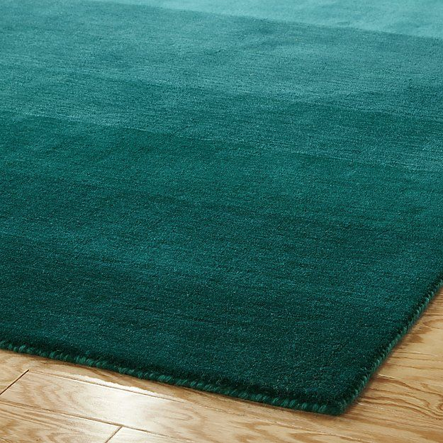 Shop ombre teal rug 6'x9'.   Handloomed from soft New Zealand wool, plush teal runs the spectrum from light to dark creating a variegated ombre effect.  Tonal palette adds depth and interest—-a modern step up from the standard solid.