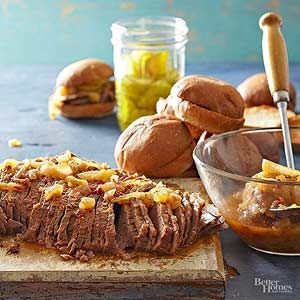 Pack some tang and heat into this brisket with beer and chili sauce. Fork slices of meat onto kaiser rolls for a hearty sandwich./