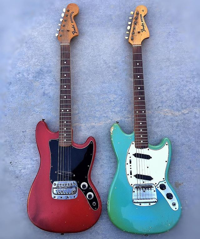 """Instagram media otisserie - There's some red white and blue hiding in this photo- what's not hiding is the shear RADNESS that Leo Designed. The love I have for these Fender guitar models goes deep. On the left-1967 or 68 Fender Bronco with a Dimarzio Fast track 2 (a pickup I suggested he install for maximum gain without digging a massive hole in the body) the fiesta red is stock and beat. On the right-a 1964 Fender Mustang with a """"A"""" neck meaning neck width of 1 1/2 I think. Blue as the…"""