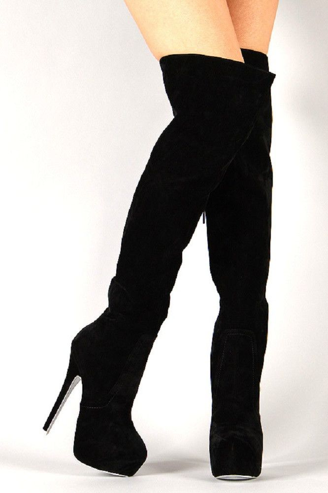 Feel the fashion force in this stunning thigh high boot! Featuring almond toe, smooth faux suede upper, partial elastic insert at the top, concealed platform, and stiletto heel. Finished with cushione