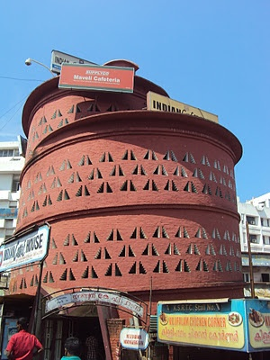 The Indian Coffee House at Thampanoor, Thiruvananthapuram is the 'trippiest', designed by Laurie Baker, it just goes round and round ...