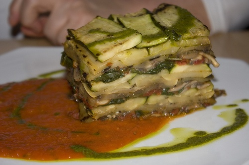 Vegan No-oil Grilled Vegetable Terrine (zucchini, potato, spinach, summer squash, onions, mushrooms with a tomato sauce and basil pesto drizzle) So easy to do at home. The Press method is used. Need a restaurant hotel pan with holes and another to place on top so the liquid can drain. I can so do this!