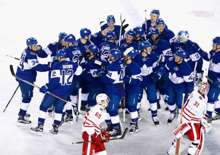 The Toronto Maple Leafs celebrate the overtime winner scored by Auston Matthews #34 to defeat the Detroit Red Wings 5-4 in the 2017 Scotiabank NHL Centennial Classic at Exhibition Stadium on January 1, 2017 in Toronto, Ontario, Canada