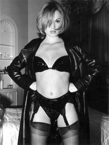 Amanda Holden 6|Amanda Holden 6||black and white|B&W|woman|lingerie|bra|suspenders|knickers|stockings|curtains|shadow|bed|look|eyes|hands|on|hips|black|leather|coat|fringe|face