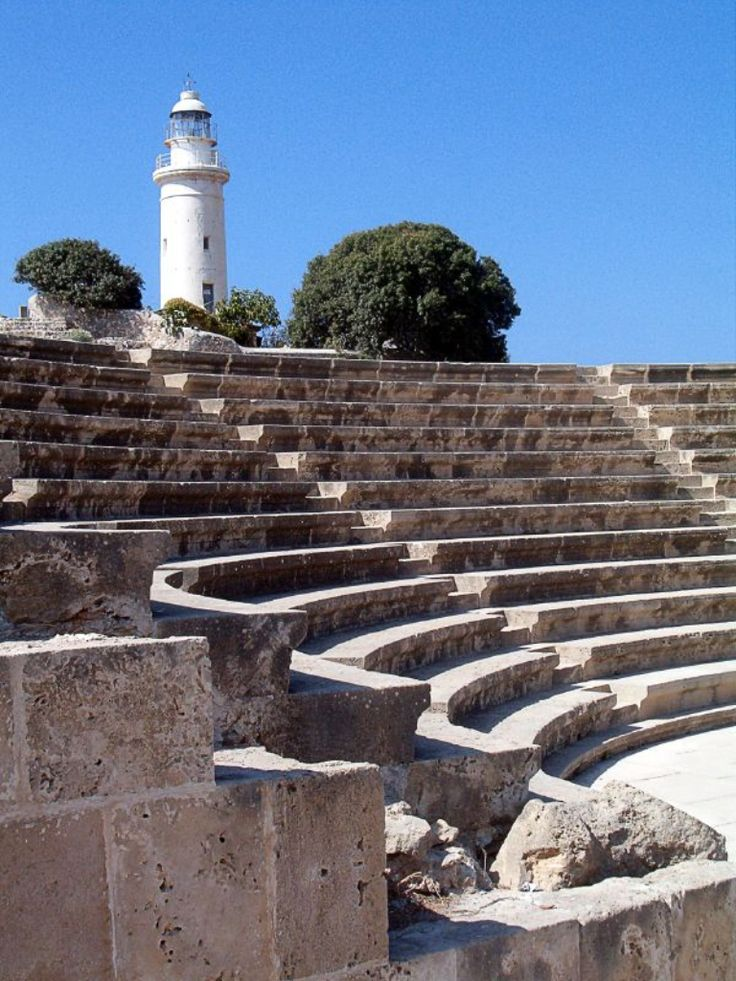 Ancient Roman Odeon Theatre with Paphos Lighthouse, Cyprus. http://WhatIsTheBestMountainBike.com