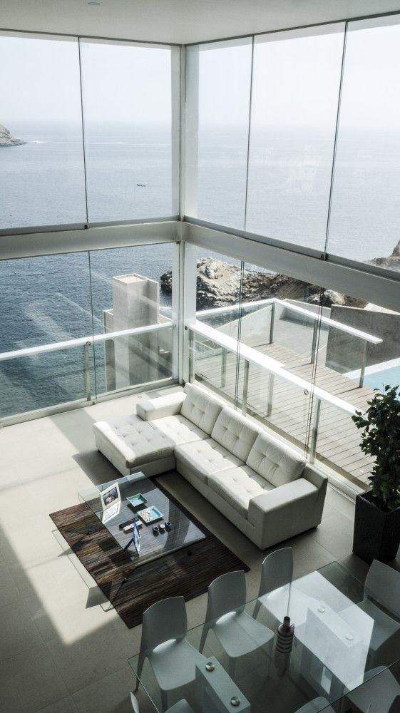 Pc House / EDDICO The soaring ceilings and windows are amazing --- the view of the ocean, priceless