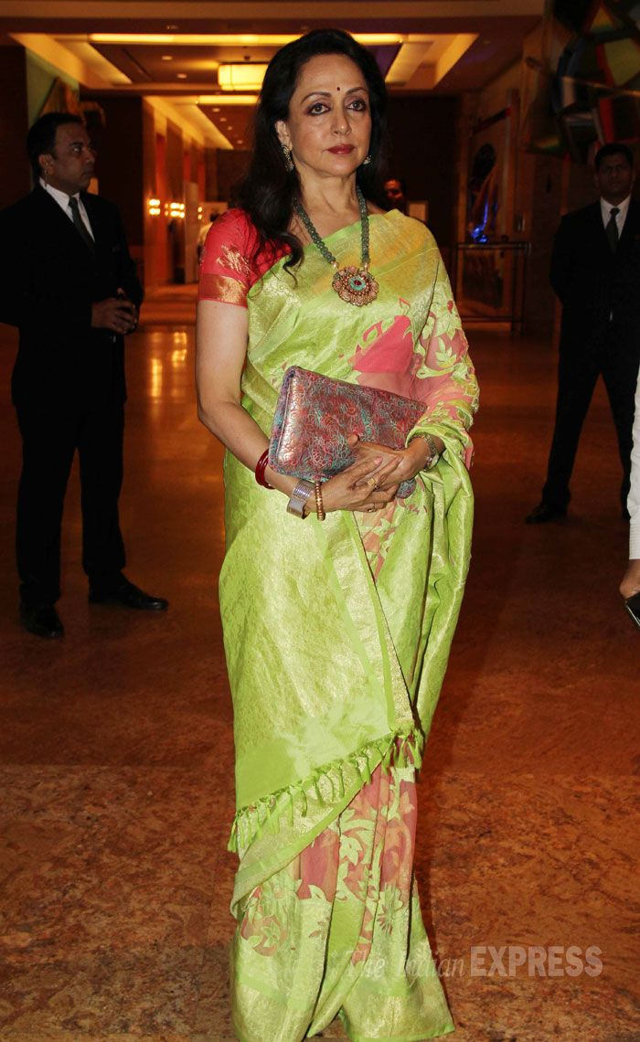 Oct 20, 13: Hema Malini in a lime green saree with a neon orange blouse. (IEx Photo: Varinder Chawla)
