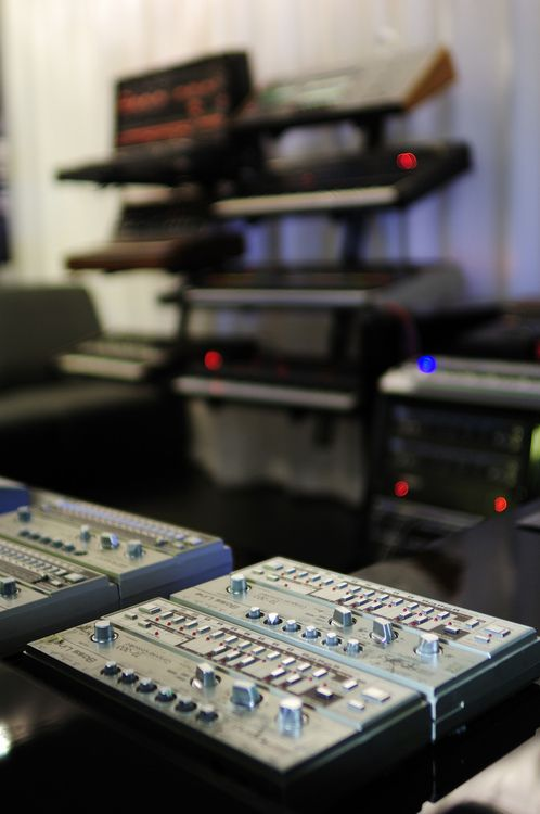 Roland TB-303 in foreground. Very popular for strong bass lines.