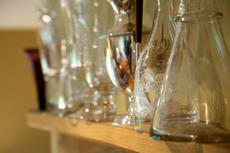 A collection of decanters, jugs and jars