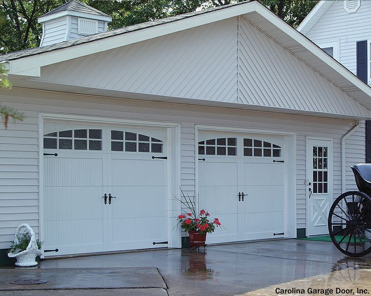 Carriage garage doors with the back of an actual carriage in front. Way to go all out. The average price to install a new garage door is $964.
