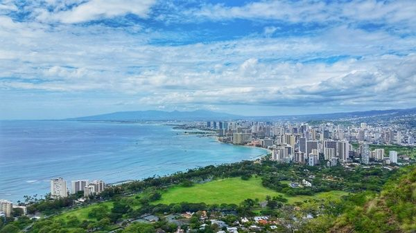 The Diamond Head Trail is possibly the most famous hiking trail in all of Hawaii. This is the trail that gets you those iconic views on top of Waikiki and downtown Honolulu! Going for the Diamond Head hike in the morning, followed by some snorkeling in Waikiki at Queens Beach, can make for a perfect day on Oahu! #tripreviewer #hiking #skiing #travelblog #booking https://www.tripreviewer.com/