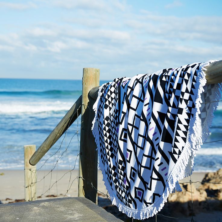 Beach Towel: large and luxurious round microfibre beach towel. Beautifully made with modern print design, an excellent beach-day companion.