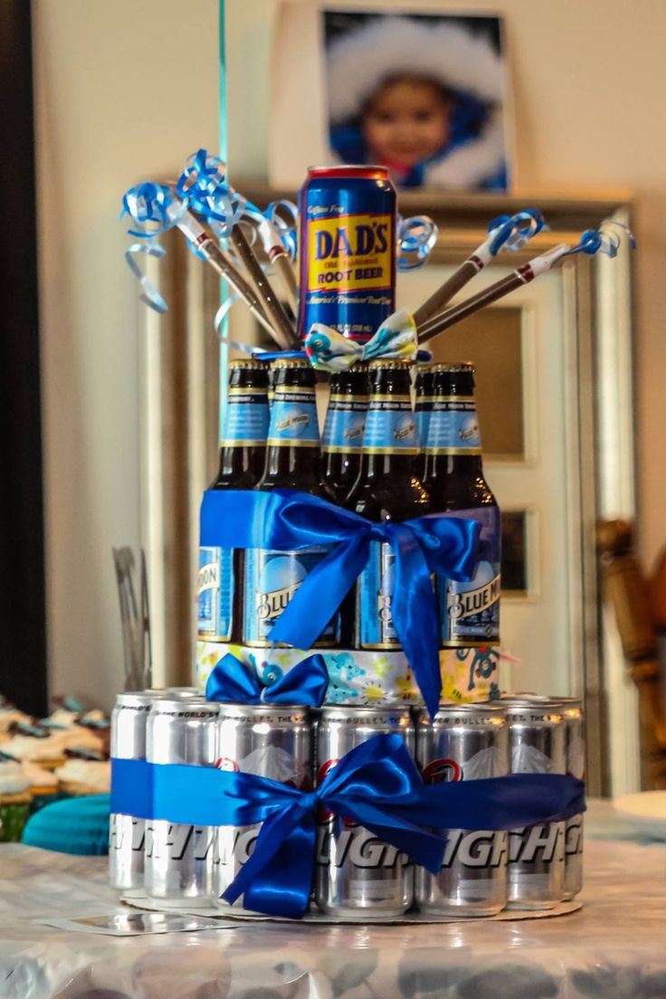 For the co-ed baby shower, this is a beer cake I made for my brother and his guy friends so they didn't feel left out of the baby shower! it's coors lite on the bottom, the middle tier is Blue Moon and the topper is a Dad's Rootbeer with Swisher Sweets. So much fun and a sure way to make the guys feel  welcome!