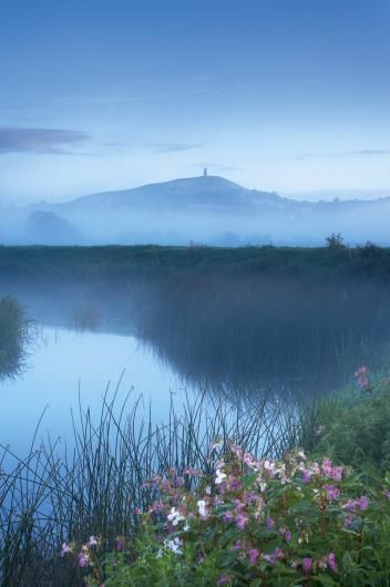 Glastonbury Tor, Somerset Levels - © David Noton. Love this view so much! When I see the tor and Wells aerial I know I'm home.