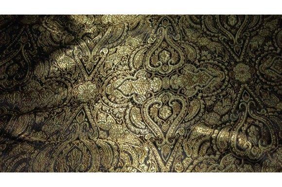 Tejido de estampado Tánger de fondo negro y motivos en tonos dorados y plateados con brillo medio. No sería necesario mojarlo previamente a la confección ya que predomina el poliéster en su composición.  Ideal para disfraces de árabe, túnicas árabes...#brocado #jacquard #tánger #dorado #plateado #árabe #negro #confección #chaquetas #faldas #traje de chaqueta #traje de pantalón #tela #telas #tejido #tejidos #textil #telasseñora #telasniños #comprar #online