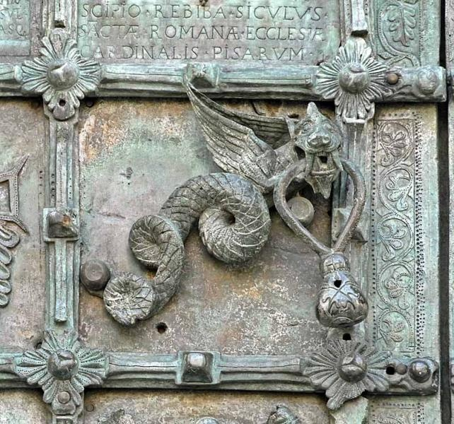 Part of an elaborate bronze door made in 1119, Troia Cathedral, Italy. Unlike the Sanctuary Knocker at Durham Cathedral