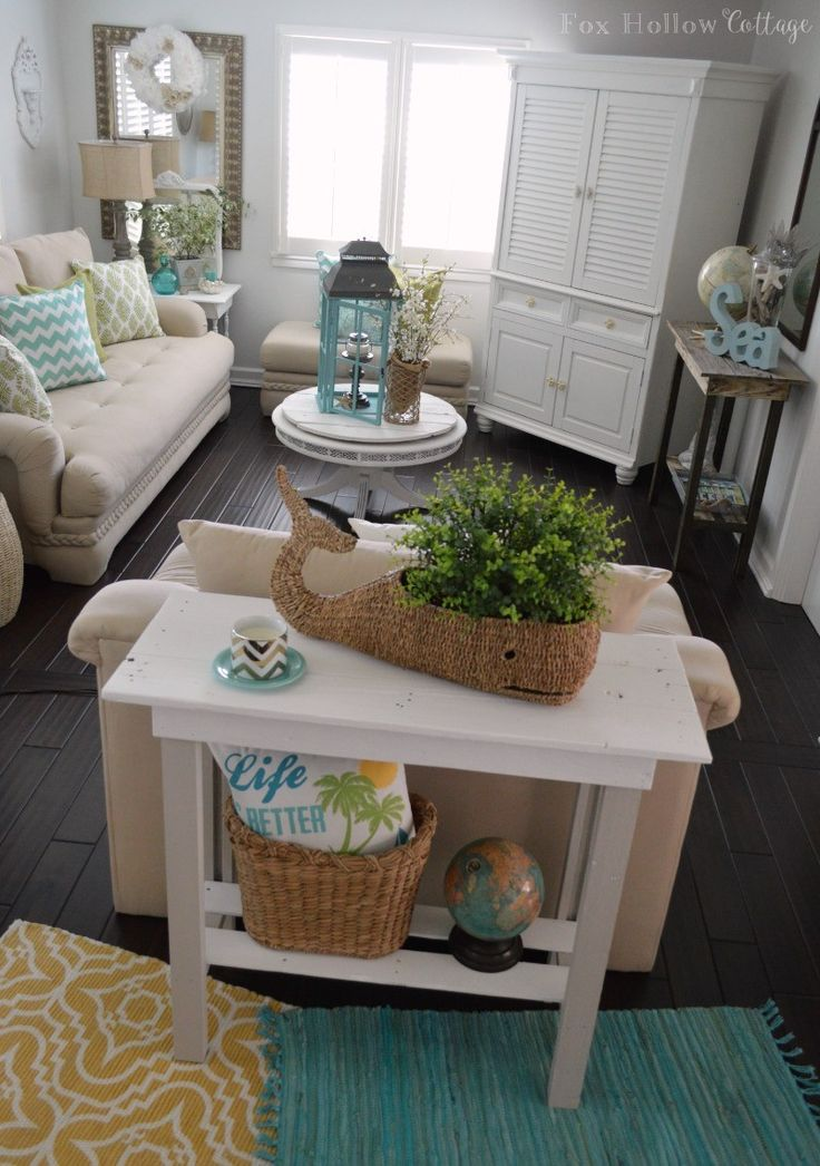 Fresh & Fun Living Room Refresh: diy reclaimed pallet wood table, painted makeover. Casual beach vibe with coastal decor in neutral, aqua, white and yellow. foxhollowcottage.com #coastal #homedeocorating #homegoodshappy