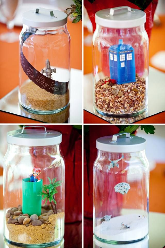 Yes, that Tardis terrarium is only a taste of the wonder that is Erin and Peter's jaw-dropping centerpieces with tiny geeky references in glass jars.