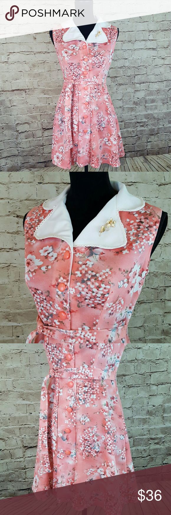"Vintage Floral Dress 1970's Salmon pink with floral motif buttons all of the way uup the front. Attatched belt ties either in front or in back. Iconic collar with rick rack epitomizes the era as does the thick polyester knit which gives a nice drape. Terrific condition. Size is vintage 11 which is alot smaller than todays equivelent, please see measurements. Love this little ""Brady"" dress! I ship fast. Shoulder to shoulder 13"" Armpit to armpit 17"" Waist 14.5"" Collar to hem 33"" Dresses"