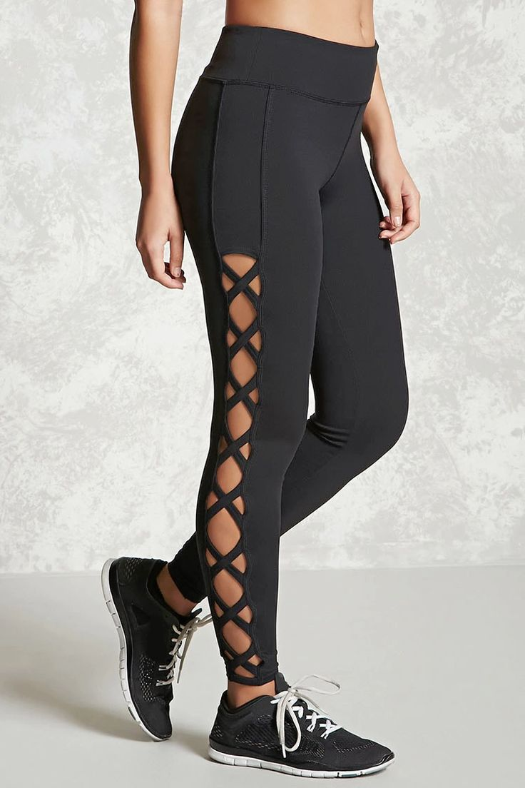 An athletic pair of long stretch-knit leggings featuring crisscross cutouts down the sides, an elasticized waist, moisture management, and a key pocket.