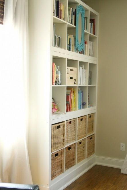 I love it! Stacked IKEA Expedite bookcases with a hand built base. Easy!