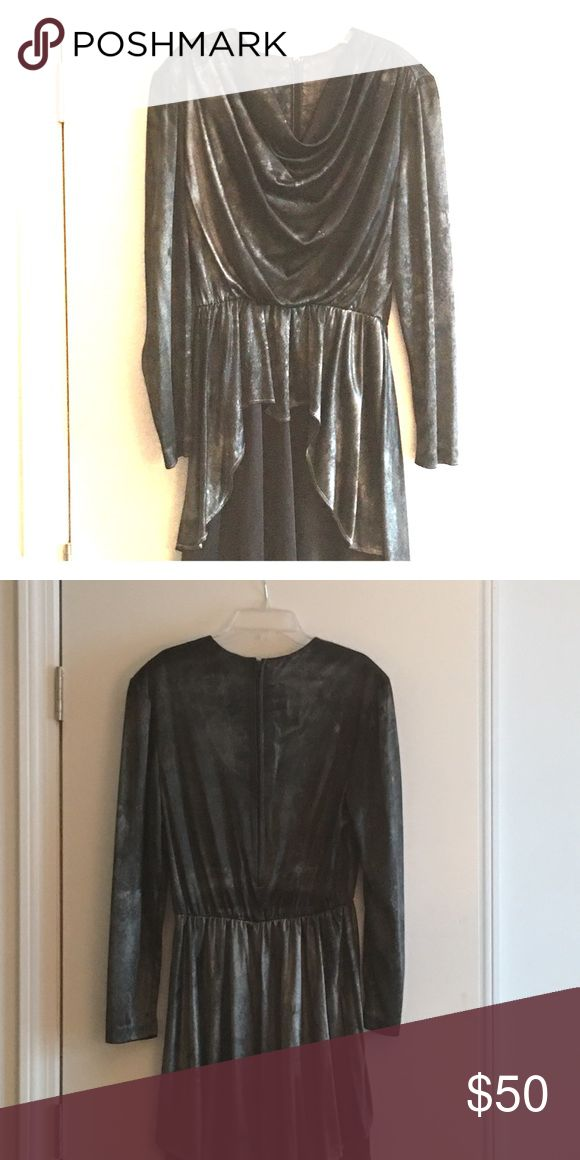 Vintage dress 90s vintage going out dress. Size Large. Short length, long sleeve,black/silver metallic silky fabric with a draped front, zipper back. I've never worn this dress, but I bought it from a vintage haute couture website. Totally fun and unique for a night out! Dresses Long Sleeve