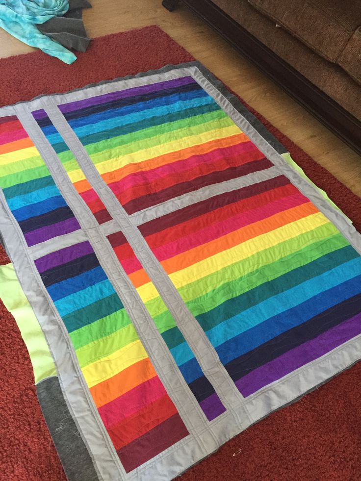 Twin sized strip quilt made with broad cloth & fleece backing. Organic wavy quilting across the stripes.