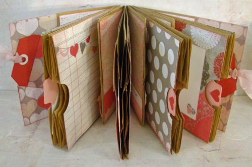 DIY sweet paper bag memory book. Perfect size for square photos and handwritten letters hidden in pull-out tabs!