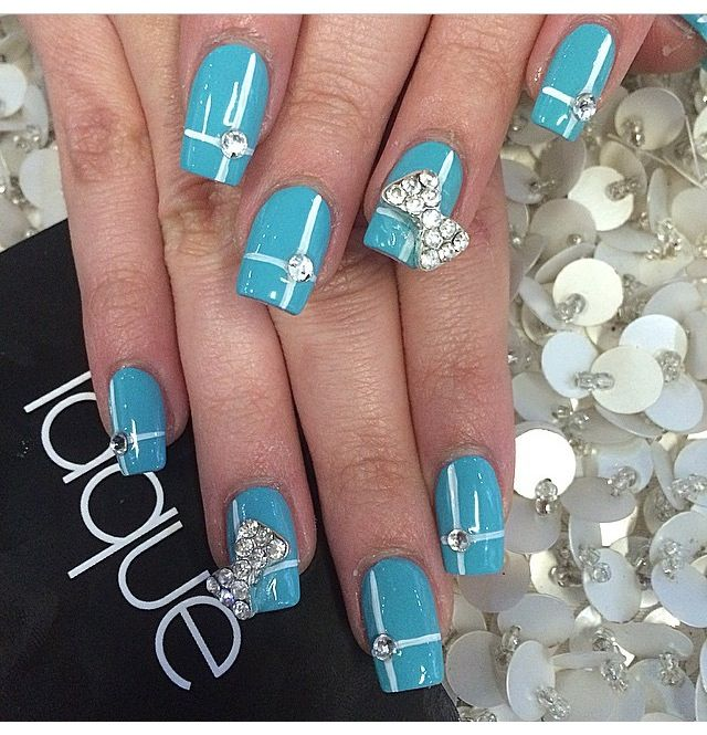 Blue, square gel nails with bows and diamonds.