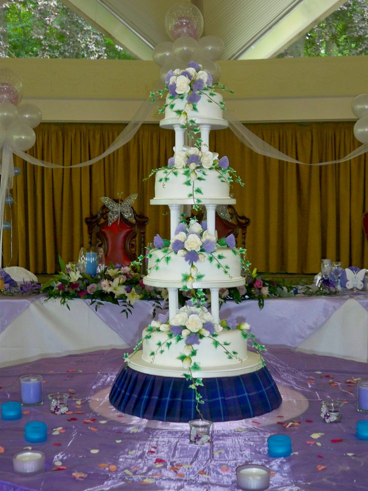 My own wedding cake with traditional Scottish Thistle and the base of cake bedecked with the same tartan as grooms kilt