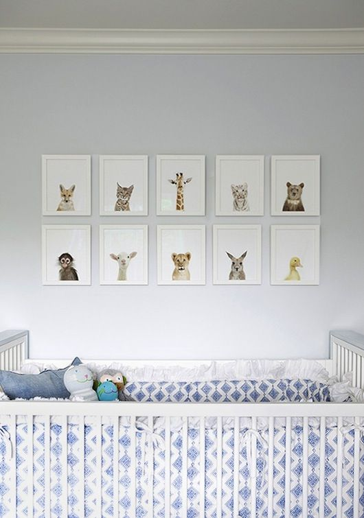 Love these animal prints above the cot in this nursery.