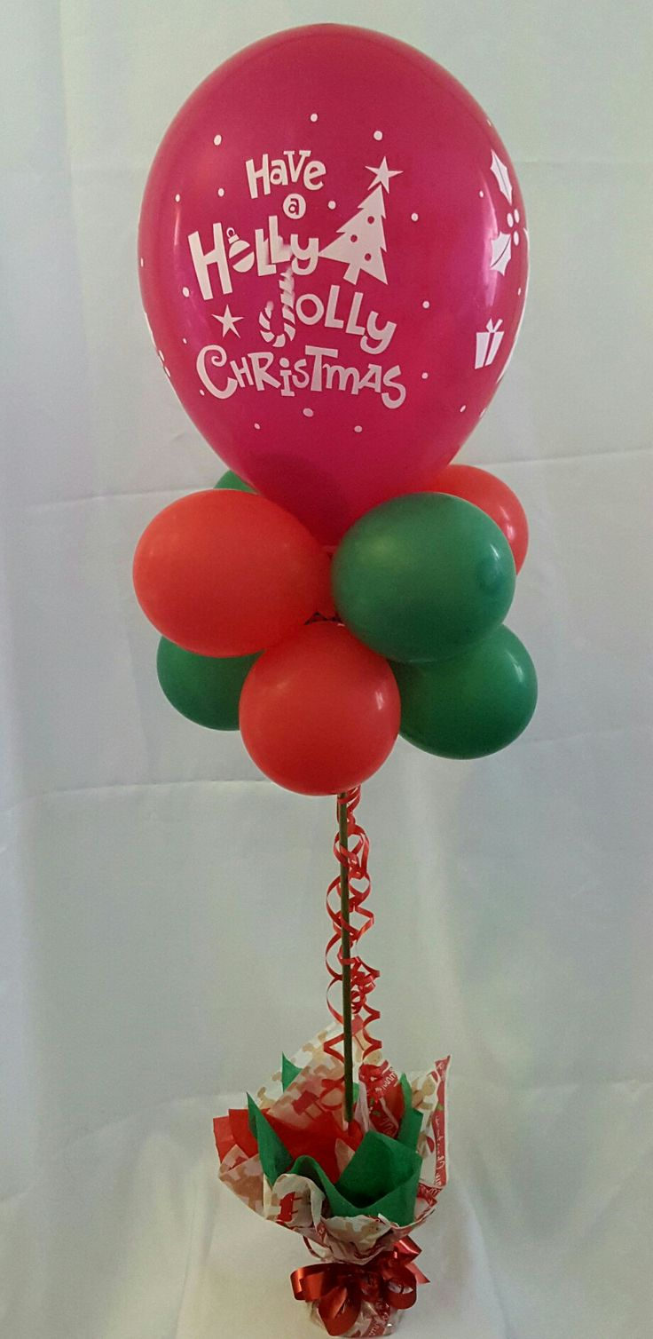 Christmas balloon topiary with a large latex balloon on top #partysolutions  #christmas #huntervalley