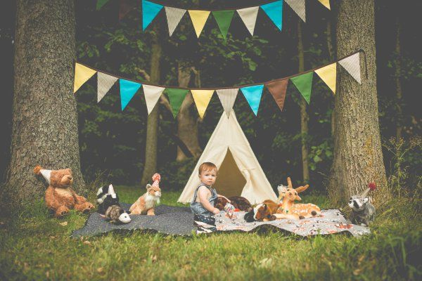 one year old toddler baby first birthday shoot woodland themed deer animals stuffed cute teepee woods forest fairy tale boy pictures photos poses kindred photo and video llc indiana outdoor shots texas longview kilgore tyler overton bullard east texas