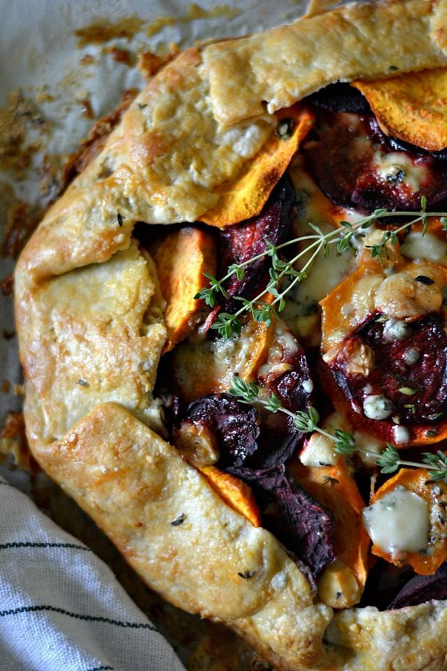 Sweet Potato and Beet Galette with Gorgonzola Cheese and Thyme via @bakeaholic