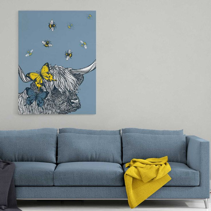 A beautiful, ready to hang stretched canvas print in various size options. Lovely Lola the Highland Cow has butterflies in her hair and a halo of buzzing bees. In a modern palette of bluey-grey with a pop of yellow, this characterful canvas looks great paired with our 'Mr Stag's Reflection' print for major wall impact!