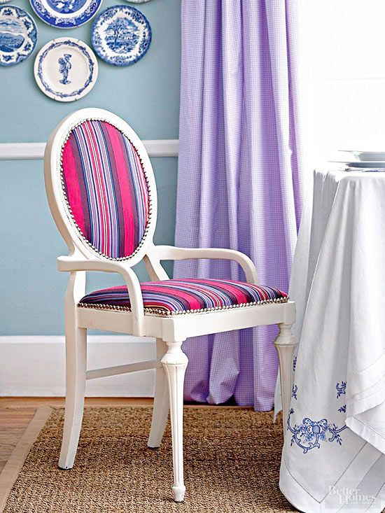 Return a traditional, yet tired chair to its former glory with nailhead trim and a bright fabric. Paint the chair. Cut an oval of fabric to fit the back. Staple into place and trim the excess. Hot-glue flat white trim around the edge to hide the staples. Cover the seat in a similar method. Finish the back and seat with nailhead trim from a bolt (available at fabric stores), which comes in a ribbon and is easier and quicker to work with than individual nailheads./