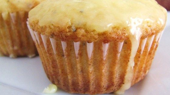 Almond extract and poppy seeds in these muffins will delight your taste buds, along with the touch of sunny orange in the buttery glaze.
