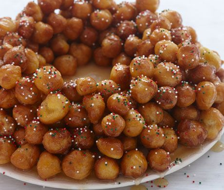 Struffoli Ingredients      2 tablespoons semolina     6 eggs     1 tablespoon sugar     zest 1 unwaxed lemon, finely grated     2 tablespoons olive oil     3–3 1/3 cups flour, plus more for rolling     1/2 teaspoon baking powder     2 1/2–3 quarts flavorless vegetable oil, for frying     1 1/2 cups honey