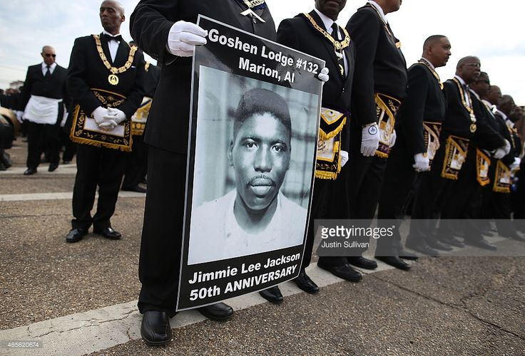 A marcher holds a poster of Jimmie Lee Jackson, a civil rights activist who was beaten and shot by Alabama State troopers in 1965, during the 50th anniversary commemoration of the Selma to Montgomery civil rights march on March 8, 2015 in Selma, Alabama. Tens of thousands of people gathered in Selma to commemorate the 50th anniversary of the famed civil rights march from Selma to Montgomery that resulted in a violent confrontation with Selma police and State Troopers on the Edmund Pettus…