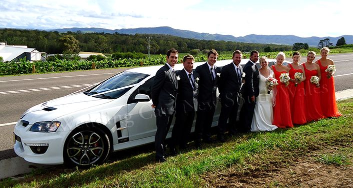 Bridal party with the HSV limousine