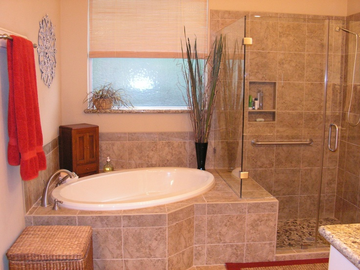 Elegant Drop In Oval Tub On A Angle To Add More Space To Room.