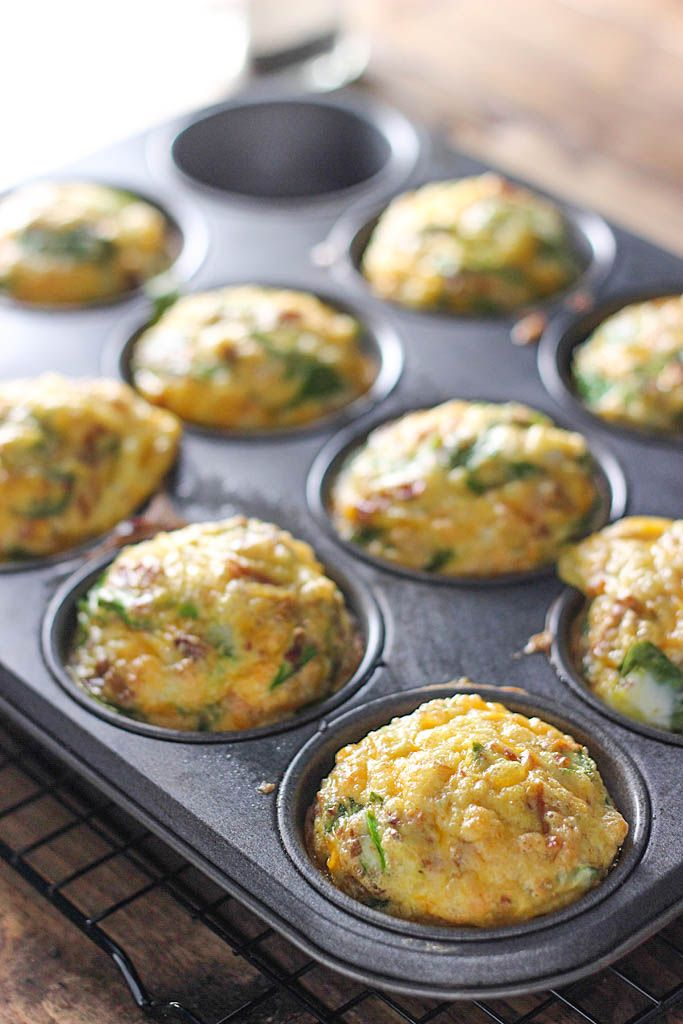 On-The-Go Breakfast Muffins - A quick and easy way to get your eggs to go. Loaded with bacon bits, cheddar cheese and spinach!