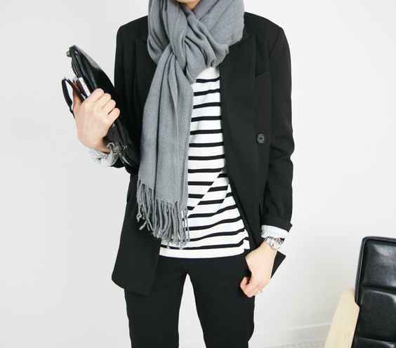 This combination of a black jacket and black chinos is perfect for off-duty occasions.   Shop this look on Lookastic: https://lookastic.com/women/looks/blazer-crew-neck-t-shirt-chinos/16205   — Grey Scarf  — Black Leather Clutch  — White and Black Horizontal Striped Crew-neck T-shirt  — Black Blazer  — Silver Watch  — Black Chinos
