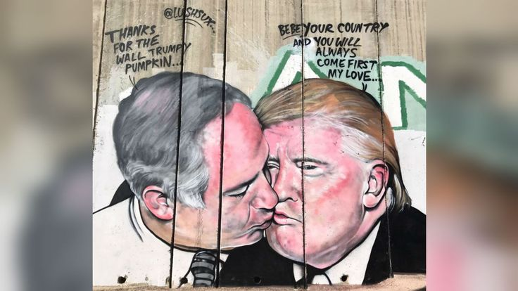 Graffiti artist paints mural of Trump kissing Israeli prime minister on West Bank wall - SBS